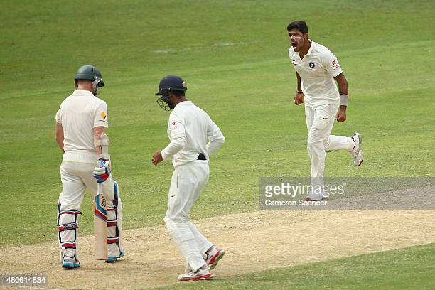 Umesh Yadav of India celebrates taking the wicket of Chris Rogers of Australia during day two of the 2nd Test match between Australia and India at...