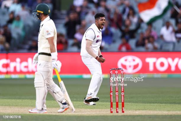 Umesh Yadav of India celebrates taking the wicket of Marnus Labuschagne of Australia during day two of the First Test match between Australia and...