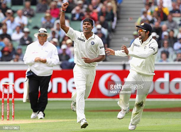 Umesh Yadav of India celebrates the wicket of Ricky Ponting of Australia during day one of the First Test match between Australia and India at...