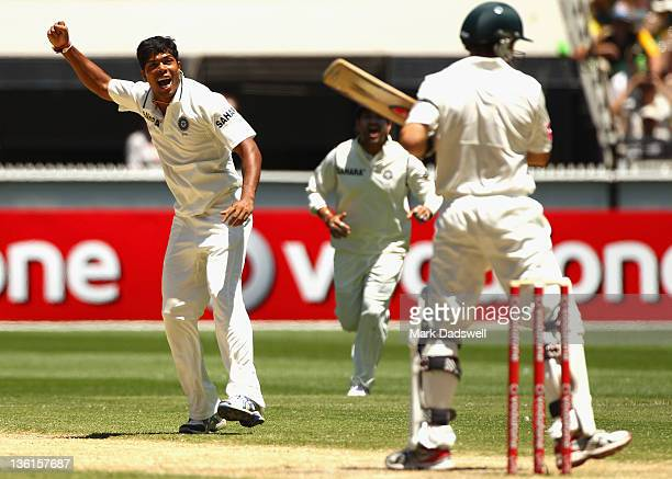 Umesh Yadav of India celebrates traping Ed Cowan of Australia LBW during day three of the First Test match between Australia and India at the...