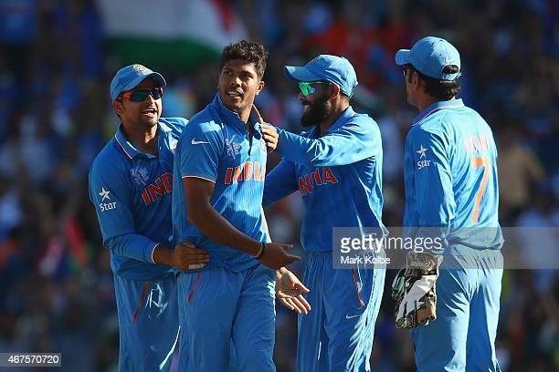 Umesh Yadav of India celebrates with his team after taking the wicket of Aaron Finch of Australia during the 2015 Cricket World Cup Semi Final match...