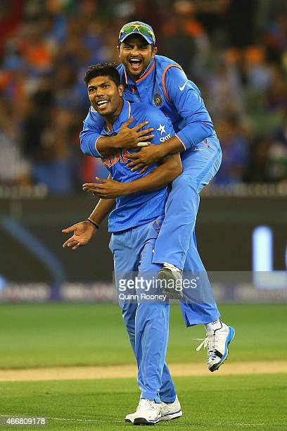 Umesh Yadav of India is congratulated by Suresh Raina after getting the wicket of Mushfiqur Rahim of Bangladesh during the 2015 ICC Cricket World Cup...