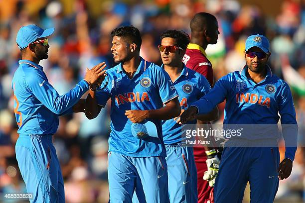Umesh Yadav of India is congratulated by team mates after dismissing Jerome Taylor of the West Indies during the 2015 ICC Cricket World Cup match...
