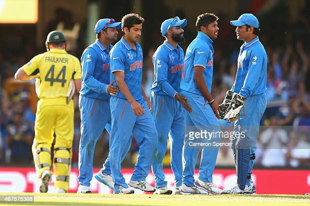 Umesh Yadav of India is congratulated by team mates after dismissing James Faulkner of Australia during the 2015 Cricket World Cup Semi Final match...