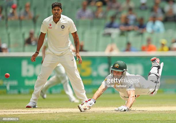 Umesh Yadav of India looks on as Shaun Marsh of Australia is run out out for 99 runs during day five of the Third Test match between Australia and...