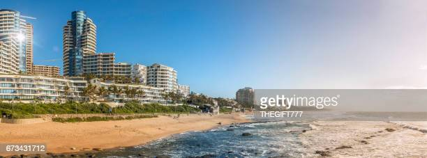 umhlanga rocks holiday flats panorama with the seaside - durban beach stock photos and pictures