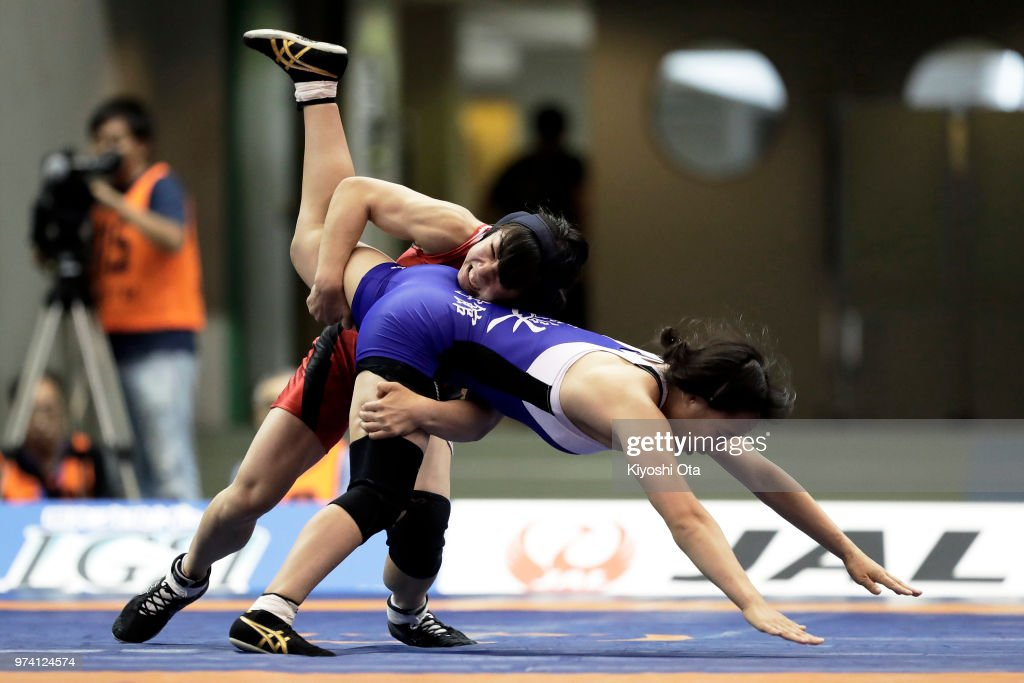 Umi Imai (L) competes against Saki Igarashi in the Women's 55kg semifinal match on day one of the All Japan Wrestling Invitational Championships at Komazawa Gymnasium on June 14, 2018 in Tokyo, Japan.
