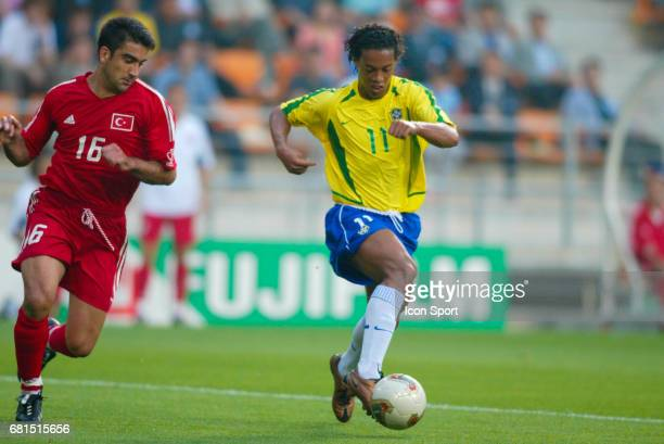 Umit Ozat of Turkey and Ronaldinho of Brazil during the World Cup match between Brazil and Turkey at Ulsan Munsu Football Stadium, Ulsan, South Corea...