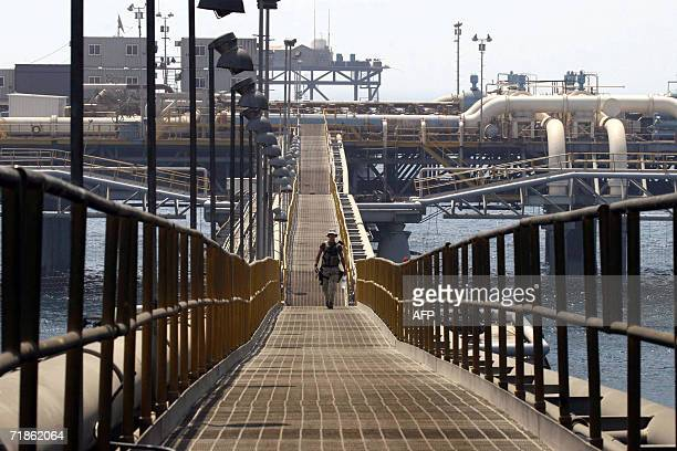 A soldier walks on a platform at the Basra Oil Terminal twelve nautical miles off the Iraqi coast in the waters of the Northern Arabian Gulf close to...