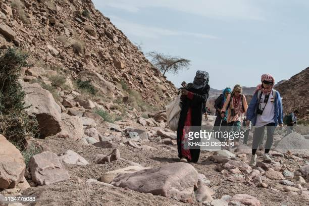 Umm Yasser an Egyptian Bedouin woman guide from the Hamada tribe leads a group of hikers in Wadi elSahu in South Sinai governorate on March 29 during...