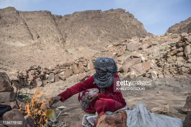 Umm Yasser an Egyptian Bedouin woman guide from the Hamada tribe prepares tea for a group of hikers in Wadi elSahu in South Sinai governorate on...
