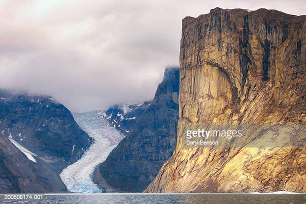 ummiguqjuaq rock face and glacier - baffin island stock pictures, royalty-free photos & images