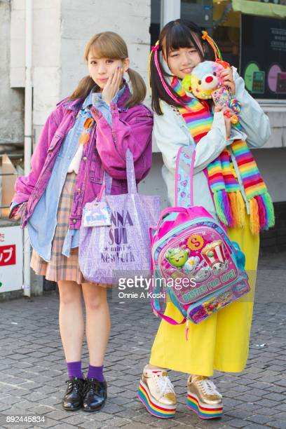 Umo and Kanpei stop for a quick fashion snap on Harajuku on December 03 2017 in Tokyo Japan Umo has dyed blond hair and pigtails wearing a pink denim...