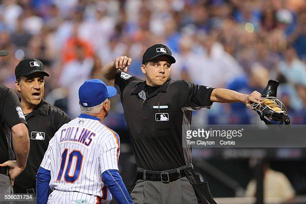 Umpire Adam Hamari tosses Manager Terry Collins of the New York Mets after tossing Noah Syndergaard of the New York Mets for throwing at Chase Utley...