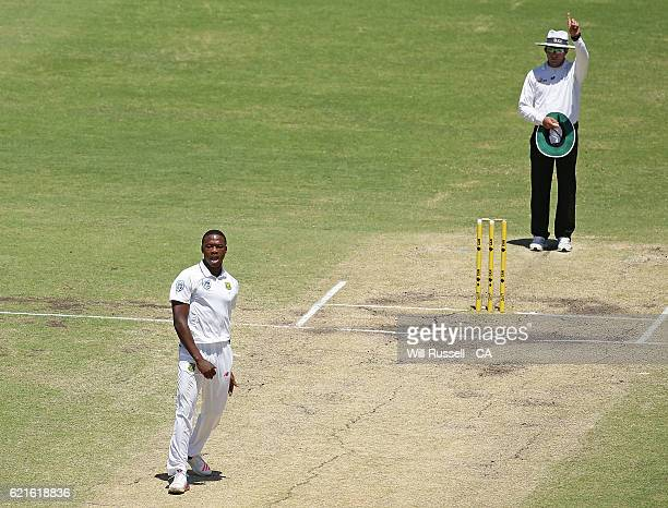Umpire Aleem Dar signals out to Mitchell Starc of Australia off a ball from Kagiso Rabada of South Africa during day five of the First Test match...