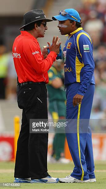Umpire Asad Raufand and Mahela Jayawardene of Sri Lanka exchange heated words during the second One Day International Final series match between...