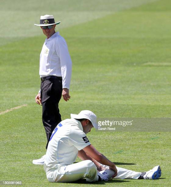 Umpire Ben Treloar watches Daniel Solway during day one of the Sheffield Shield match between South Australia and New South Wales at Adelaide Oval on...