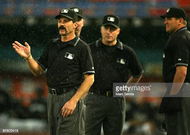 Umpire Bill Hohn checks the weather as the Florida Marlins plays against the Houston Astros in the first inning on September 18 2008 at Dolphin...