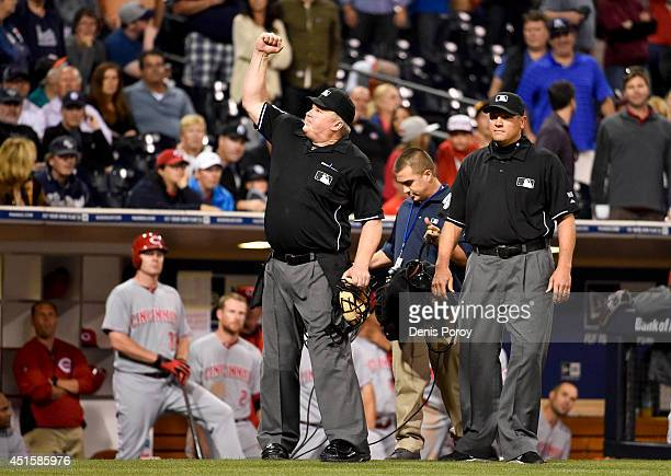 Umpire Bill Miller signals the final out in the ninth inning after an instant replay review during a baseball game between the San Diego Padres and...