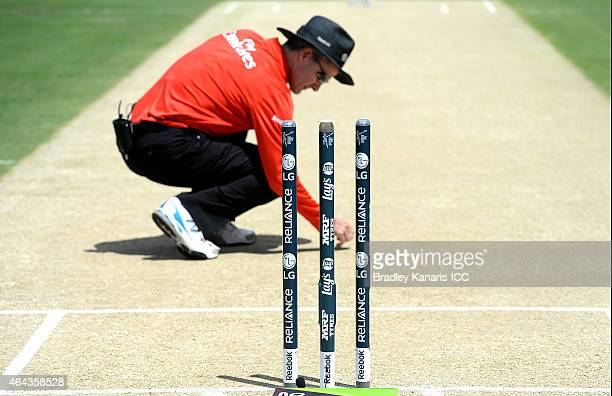 Umpire Billy Bowden inspects the pitch before the start of the 2015 ICC Cricket World Cup match between Ireland and the United Arab Emirates at The...