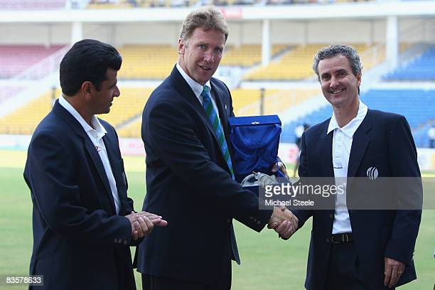 Umpire Billy Bowden is presented with a plaque for his 50th Test by match referee Chris Broad alongside fellow umpire Aleem Dar during day one of the...