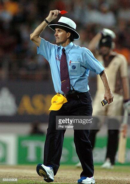 Umpire Billy Bowden shows Australian bowler Glen McGrath a red card after he bowled an underarm delivery to Black Caps Kyle Mills in the first ever...