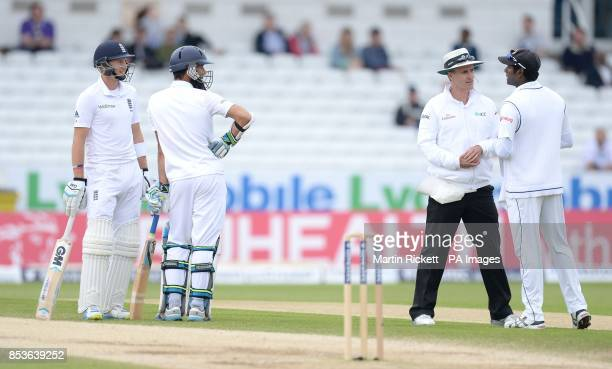 Umpire Billy Bowden talks with Sri Lanka's Angelo Matthews as England's Joe Root and Moeen Ali look on during day five of the second Investec Test...