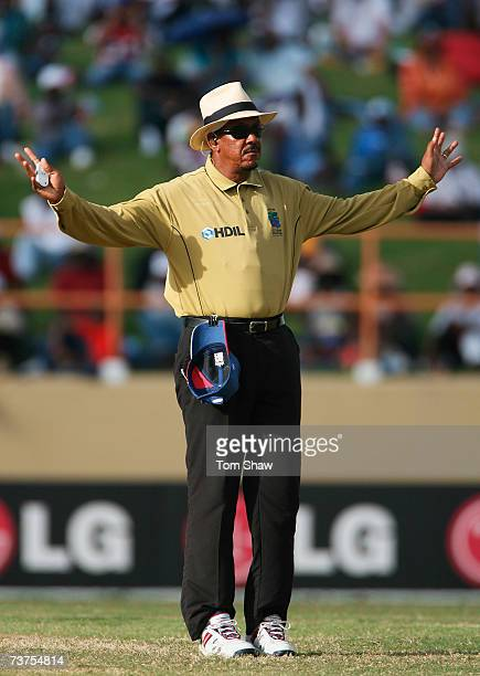 Umpire Billy Doctrove signals a wide ball during the ICC Cricket World Cup Super Eights match between England and Ireland at the Guyana National...