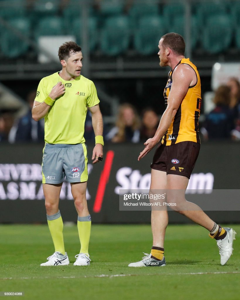 Umpire Brendan Hosking and Jarryd Roughead of the Hawks share a conversation after the final siren during the AFL 2018 JLT Community Series match between the Hawthorn Haws and the Carlton Blues at UTAS Stadium on March 10, 2018 in Launceston, Australia.