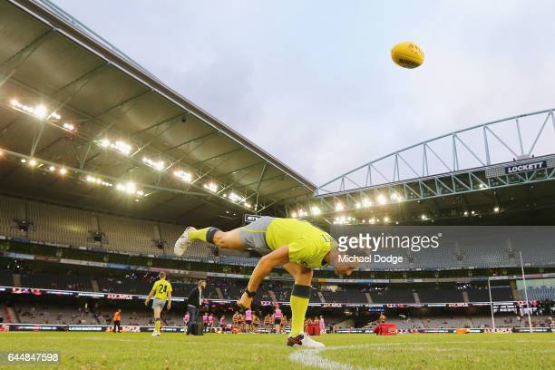 Umpire Brett Rosebury bounces the ball in the warm up during the JLT Community Series AFL match between the Richmond Tigers and the Adelaide Crows at...