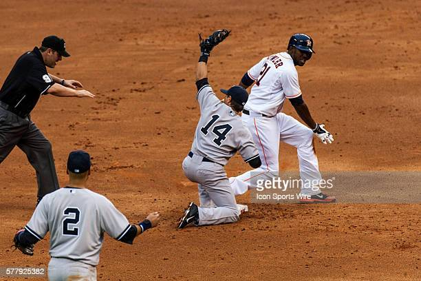 Umpire Brian Gorman with the safe call on Houston Astros right fielder LJ Hoes sliding in front of New York Yankees second baseman Brian Roberts on a...