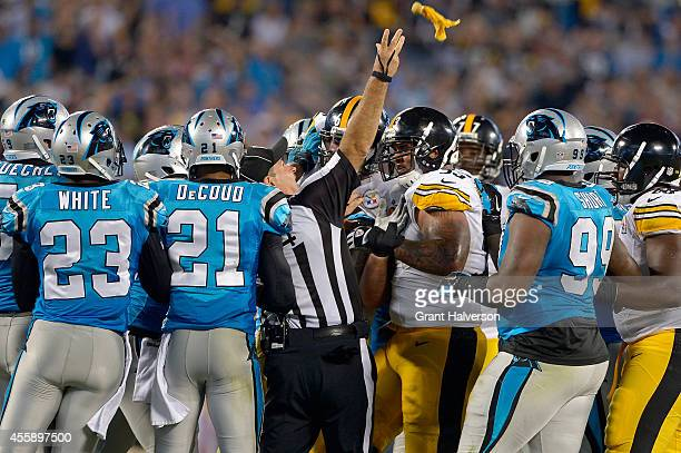 Umpire Carl Paganelli throws a flag as the Carolina Panthers and the Pittsburgh Steelers scuffle during their game at Bank of America Stadium on...