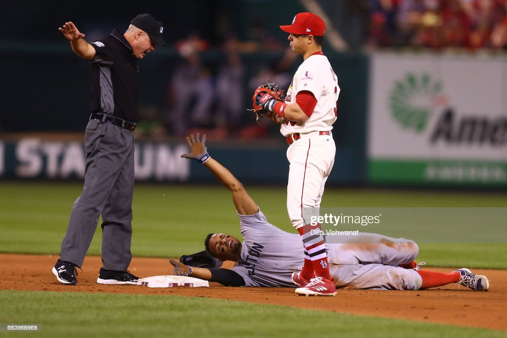 Umpire Chris Segal #96 calls Xander Bogaerts #2 of the Boston Red Sox safe on a steal of second base against Aledmys Diaz #36 of the St. Louis Cardinals in the eighth inning at Busch Stadium on May 16, 2017 in St. Louis, Missouri.
