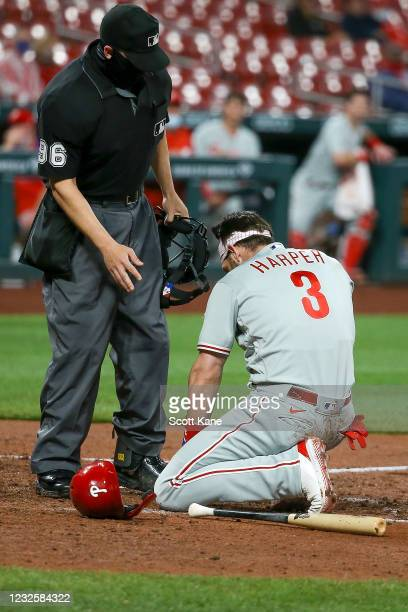 Umpire Chris Segal looks at Bryce Harper of the Philadelphia Phillies after he was hit by pitch during the sixth inning against the St. Louis...