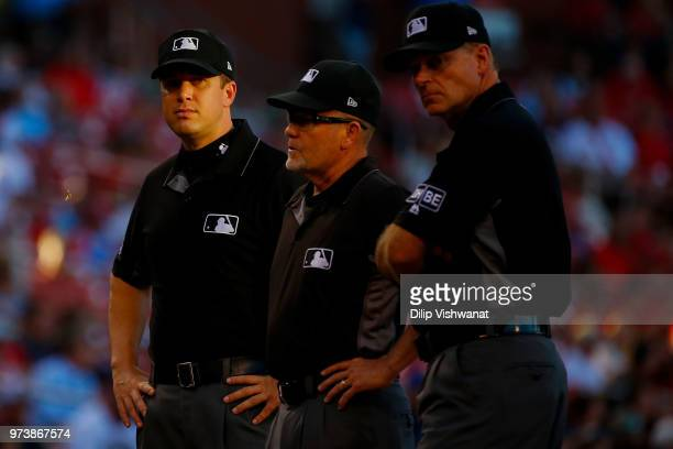 Umpire Chris Segal meets with the rest of the officiating crew prior to a game between the St Louis Cardinals and the San Diego Padres at Busch...