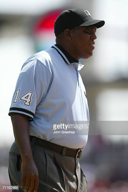 Umpire Chuck Meriwether stands during the game between the Cincinnati Reds and the Florida Marlins at Great American Ball Park in Cincinnati Ohio on...