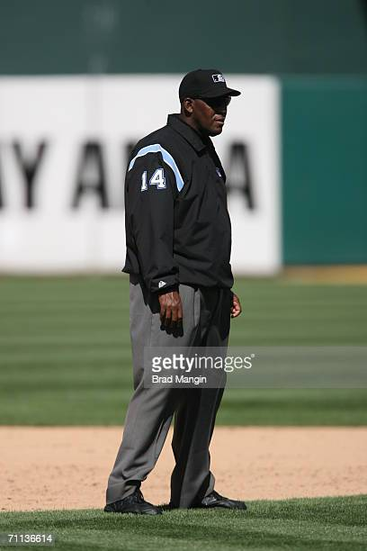 Umpire Chuck Meriwether stands on the field during the game between the Oakland Athletics and the Tampa Bay Devil Rays at the McAfee Coliseum in...