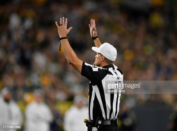 Umpire Clay Martin signals a touchdown during the game between the Green Bay Packers and the Philadelphia Eagles at Lambeau Field on September 26,...