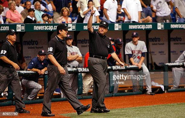 Umpire crew chief Gerry Davis calls for a home run after an instant replay review from Carlos Pena of the Tampa Bay Rays against the Minnesota Twins...