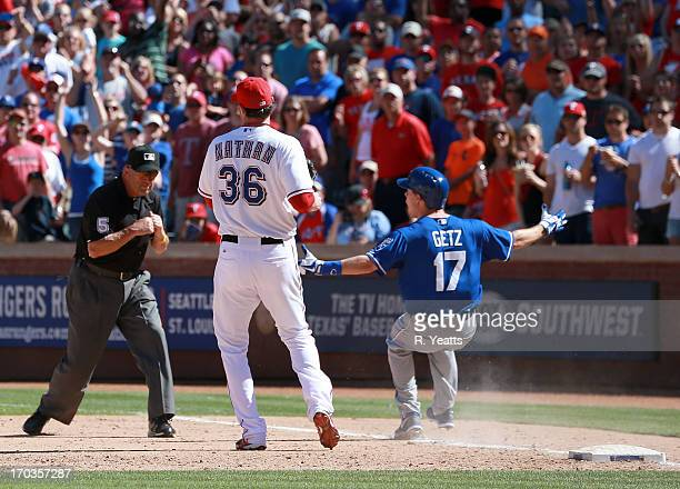 Umpire Dale Scott calls out Chris Getz of the Kansas City Royals against Joe Nathan of the Texas Rangers at Rangers Ballpark in Arlington on June 2...