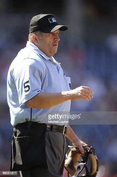 Umpire Dale Scott looks on during a baseball game between the Florida Marlins the Washington Nationals on May 8 2010 at Nationals Park in Washington...