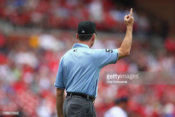 Umpire Dale Scott signals a home run as the Cincinnati Reds play against the St Louis Cardinals at Busch Stadium on September 4 2011 in St Louis...