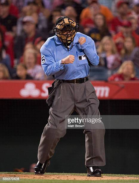 Umpire Dale Scott signals an out call during the game between the Los Angeles Angels of Anaheim and the Baltimore Orioles at Angel Stadium of Anaheim...