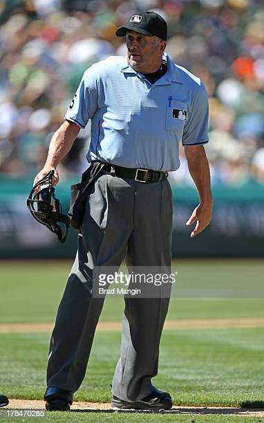 Umpire Dale Scott works during the game between the Texas Rangers and Oakland Athletics at Oco Coliseum on Saturday August 3 2013 in Oakland...
