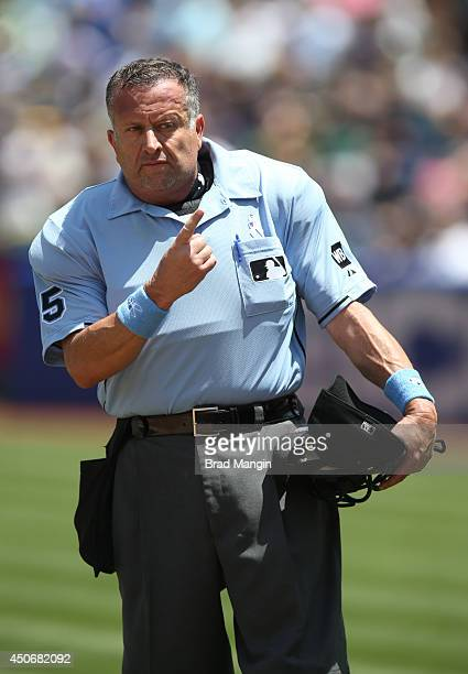 Umpire Dale Scott works home plate during the game between the New York Yankees and Oakland Athletics at Oco Coliseum on Sunday June 15 2014 in...