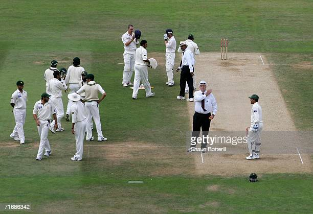 Umpire Darrell Hair signals five penalty runs during day four of the fourth npower test match between England and Pakistan at the Oval on August 20...