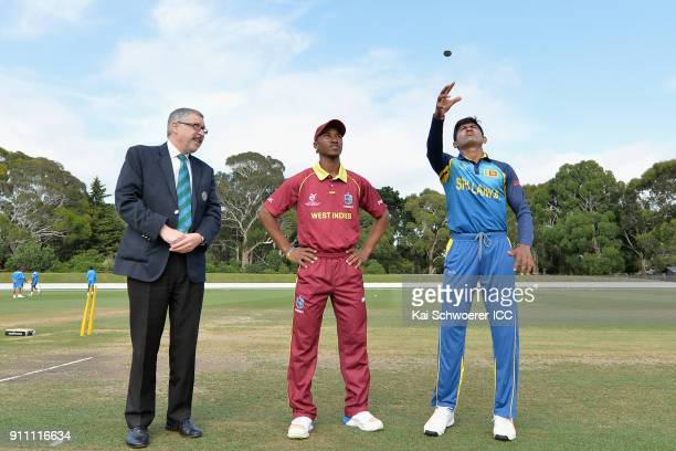 Umpire David Jukes captain Emmanuel Stewart of the West Indies and captain Kamindu Mendis of Sri Lanka take part in the coin toss prior to the ICC...