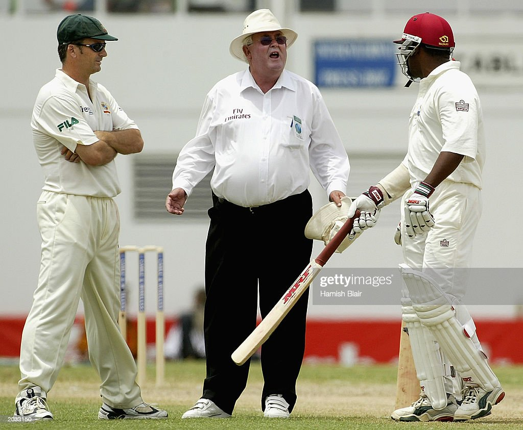 Umpire David Shepherd comes between Steve Waugh of Australia and Brian Lara of the West Indies during day two of the fourth test between the West Indies and Australia played on May 10, 2003 at the Recreation Oval in St John's, Antigua.