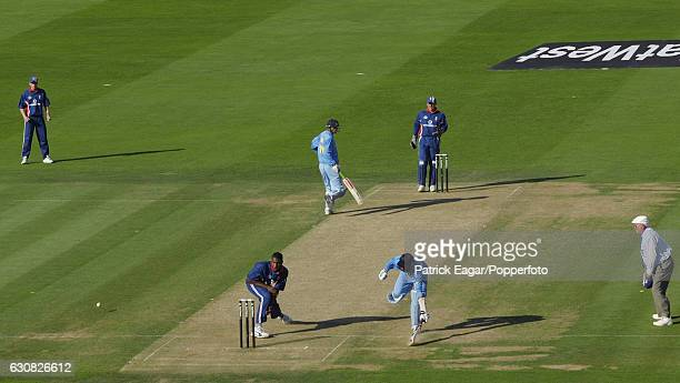 Umpire David Shepherd gets in position as England bowler Alex Tudor attempts to run out Indian batsman Harbhajan Singh during the NatWest Series...