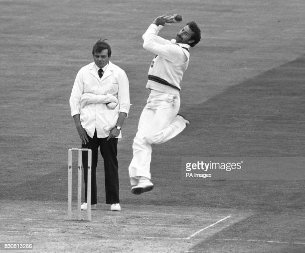 Umpire Dickie Bird watches the feet as Australian fast bowler Dennis Lillee explodes into action at the crease before his recent bout of pneumonia He...